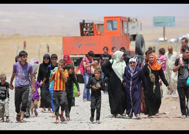 Binlerce kişi Musul'u terk ediyor 1