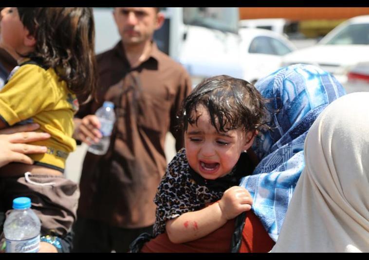 Binlerce kişi Musul'u terk ediyor 12