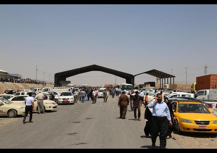 Binlerce kişi Musul'u terk ediyor 14