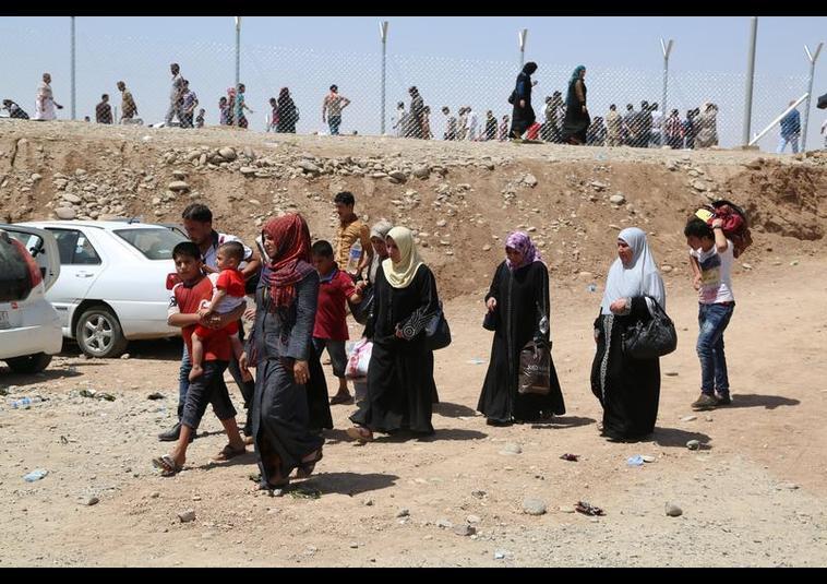 Binlerce kişi Musul'u terk ediyor 17