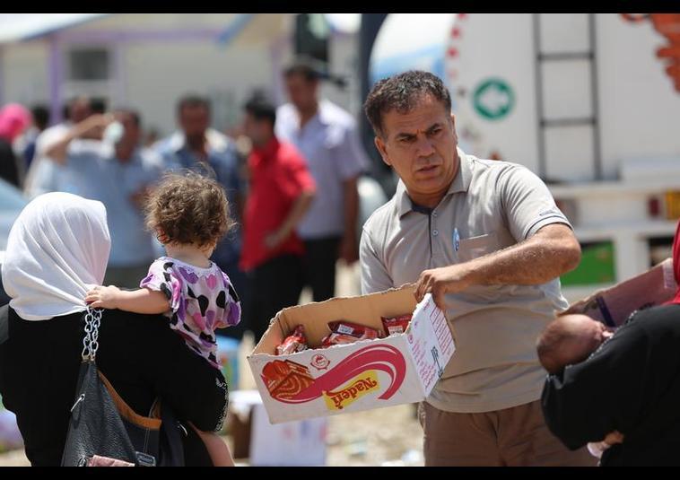 Binlerce kişi Musul'u terk ediyor 2
