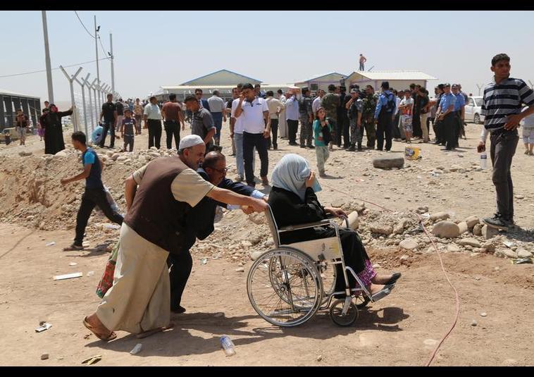 Binlerce kişi Musul'u terk ediyor 21