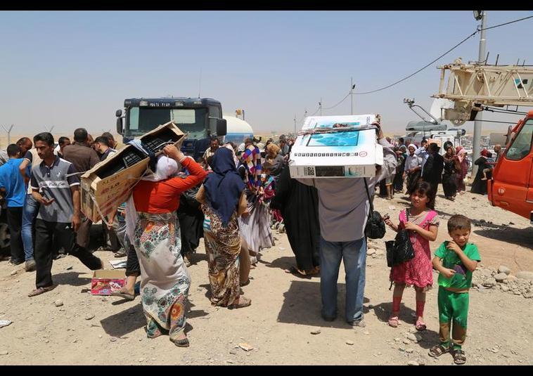 Binlerce kişi Musul'u terk ediyor 22