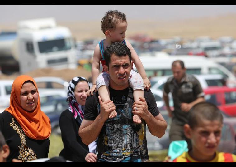 Binlerce kişi Musul'u terk ediyor 3