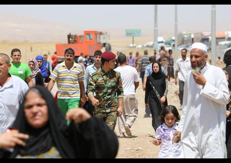 Binlerce kişi Musul'u terk ediyor 4