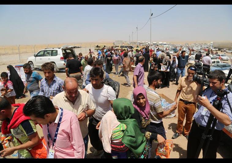 Binlerce kişi Musul'u terk ediyor 6