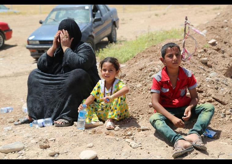 Binlerce kişi Musul'u terk ediyor 9