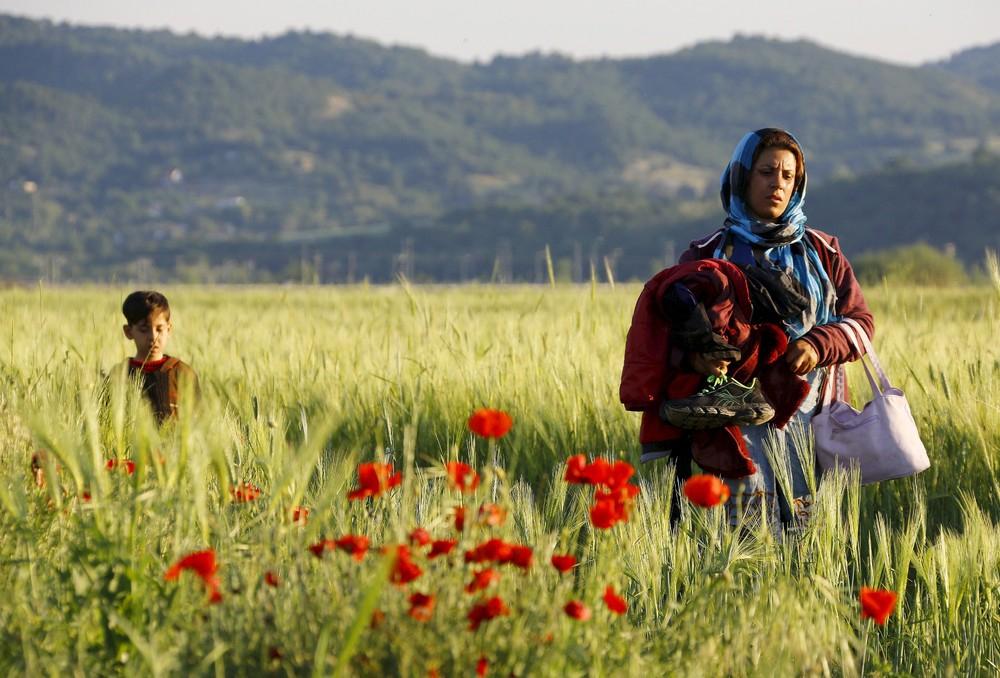 Dramı çeken mülteciler, ödülü alan fotoğrafçılar! 1
