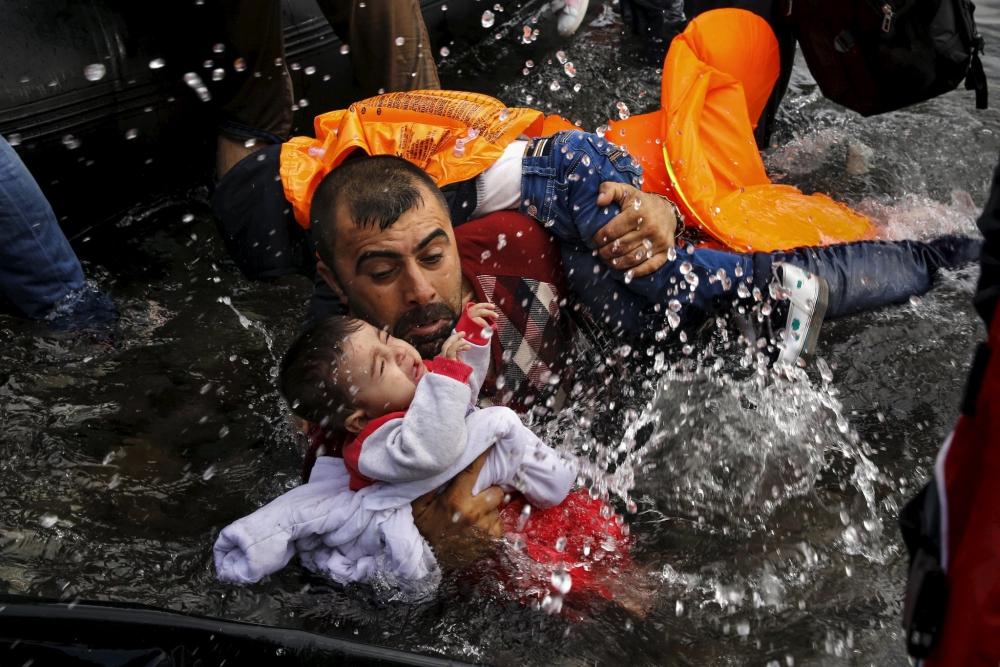Dramı çeken mülteciler, ödülü alan fotoğrafçılar! 11
