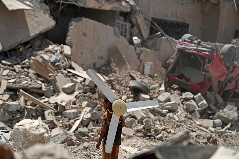 Fotoğraflara Musul'da sivillerin göçü 1