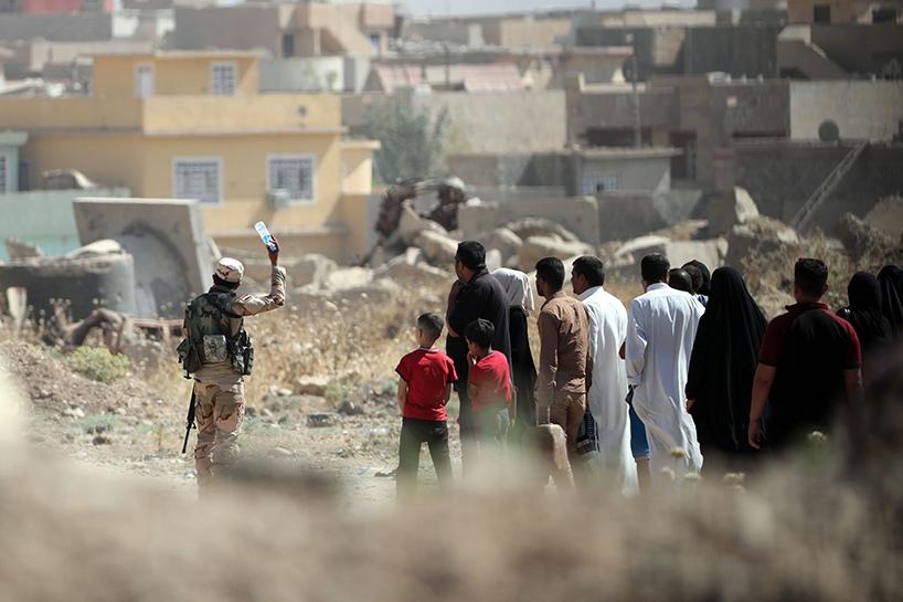 Fotoğraflara Musul'da sivillerin göçü 10