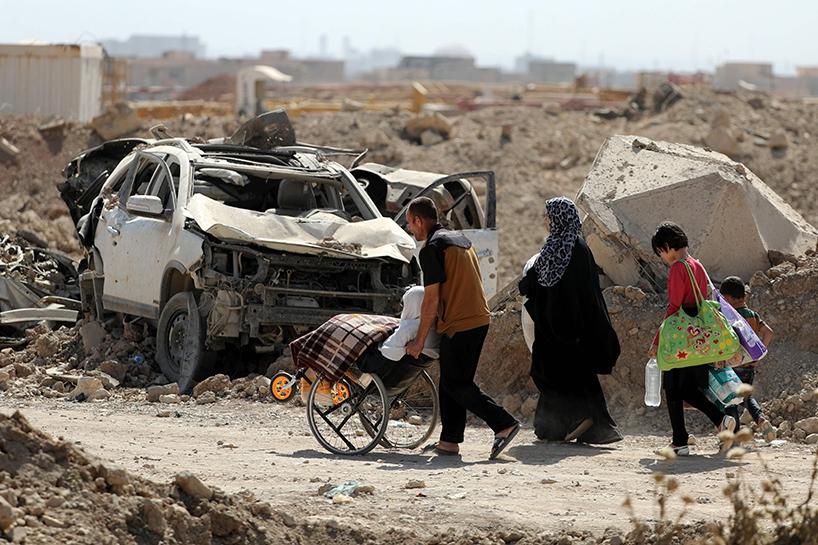 Fotoğraflara Musul'da sivillerin göçü 12