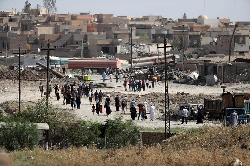 Fotoğraflara Musul'da sivillerin göçü 14