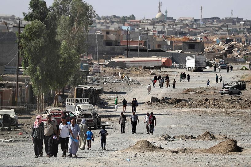 Fotoğraflara Musul'da sivillerin göçü 15