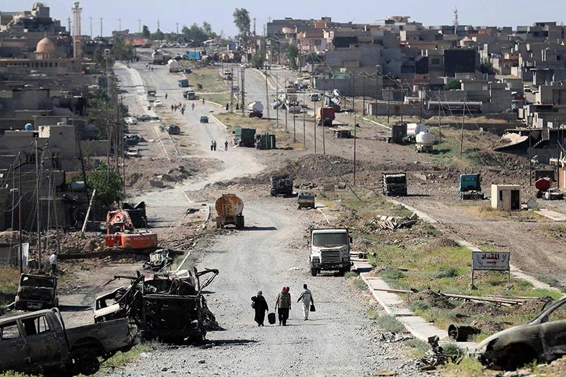 Fotoğraflara Musul'da sivillerin göçü 16