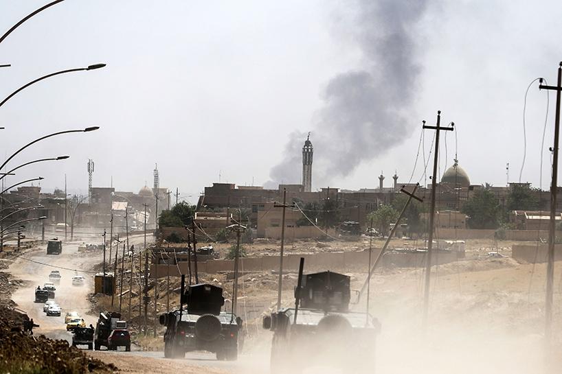 Fotoğraflara Musul'da sivillerin göçü 3