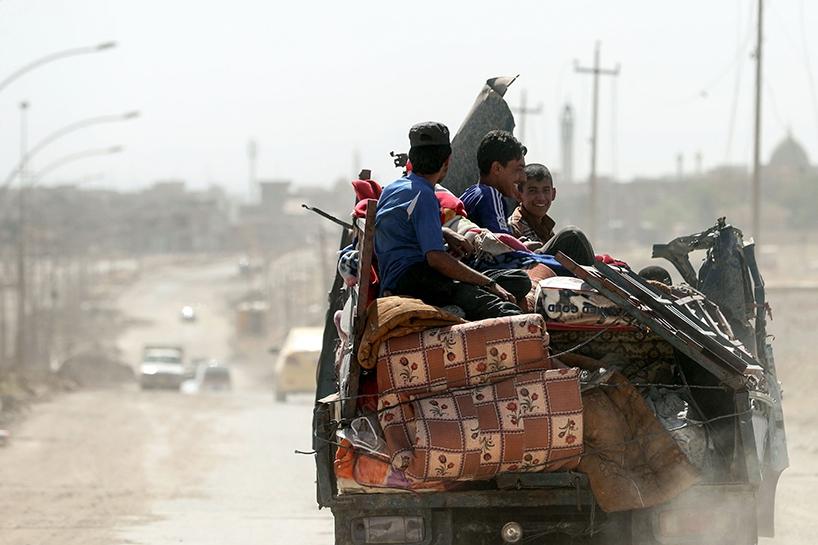 Fotoğraflara Musul'da sivillerin göçü 4