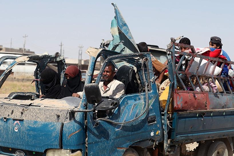 Fotoğraflara Musul'da sivillerin göçü 5