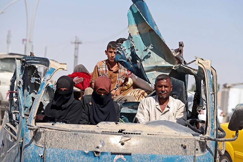 Fotoğraflara Musul'da sivillerin göçü 6