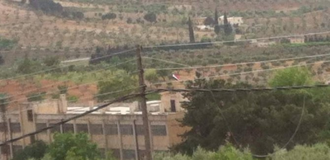 PYD'nin kontrolü altındaki Efrin'e Suriye bayrağı asıldı