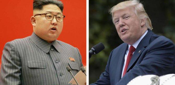 Bitirim İkili Trump ve Kim zirve için Singapur'da