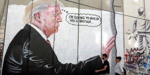 Ayrım Duvarı'nda Trump'a grafitili tepki