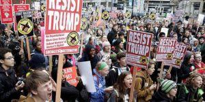 Li DYE-yê bi hezaran kes siyasetên Trump-î yên dijkoçberîyê protesto kirin