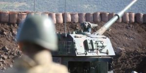 Kobani'ye obüs atışları